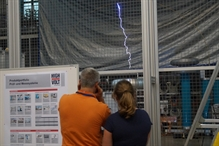 As in previous years, the visitors were especially impressed by the towering, almost futuristic test systems. One highlight was a demonstration of various high voltage experiments, yielding a series of loud bangs and flashing arcs. HIGHVOLT engineer Philipp Moritz, for example, sent an artificial bolt of lightning into a model of the Saxon State Chancellery building.